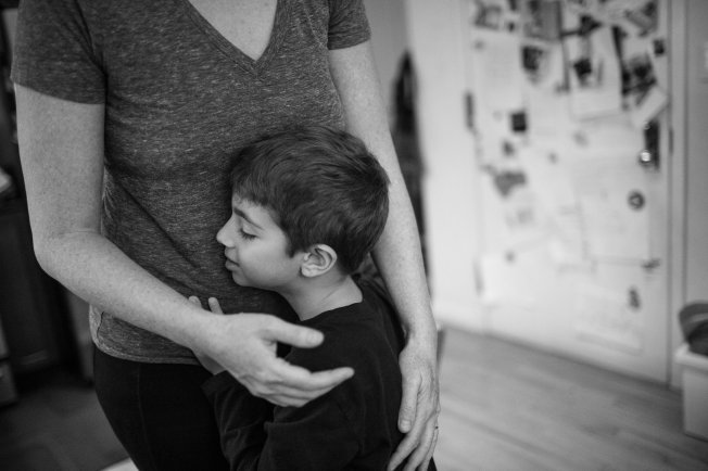 (Young A loves hugs) Photo by Geraldine Ghelli